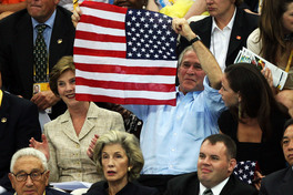 Bush holding the American flag backwards