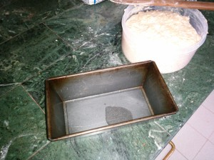 Oiling the baking tin