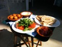 Breakfast assortment with date jam, yogurt, and flat bread